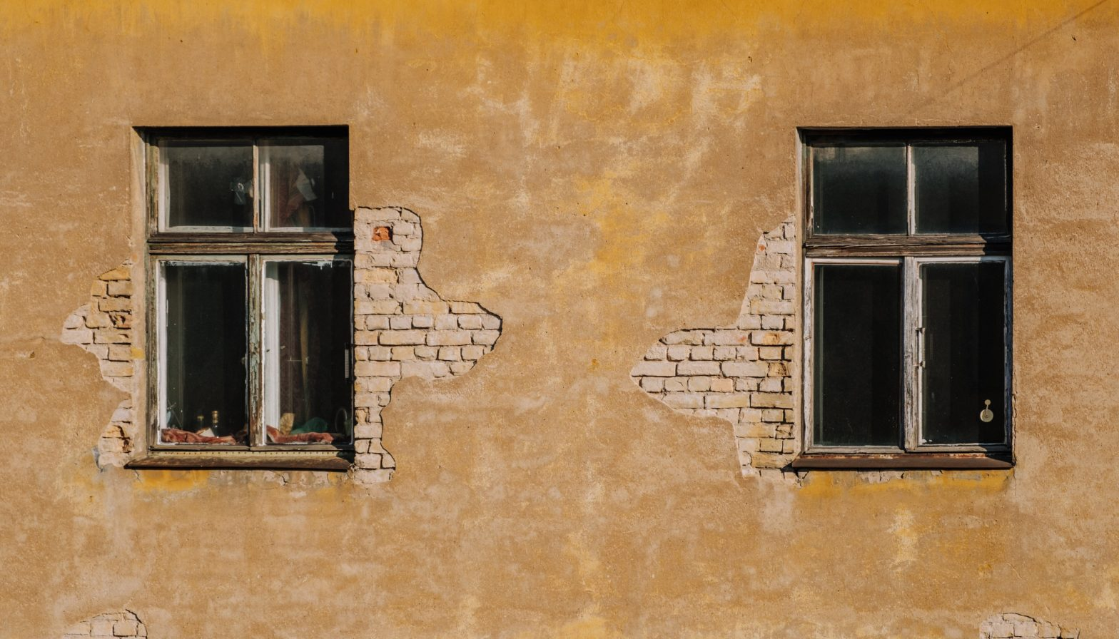 Photo of two windows of an old apartment building
